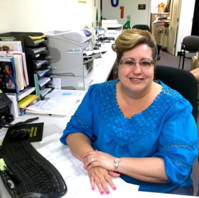 Friendliest secretary in town: Stephanie Betancur keeps CHS smiling