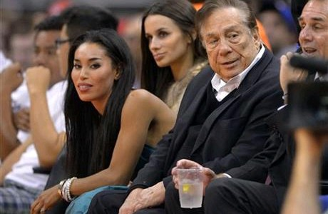 Clippers owner Donald Sterling with his friend Vanessa Stiviano at a recent game. Sterling was banned from the NBA by commissioner Adam Silver.